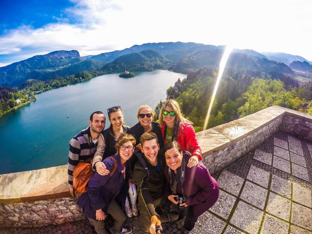 Group pose overlooking Lake Bled