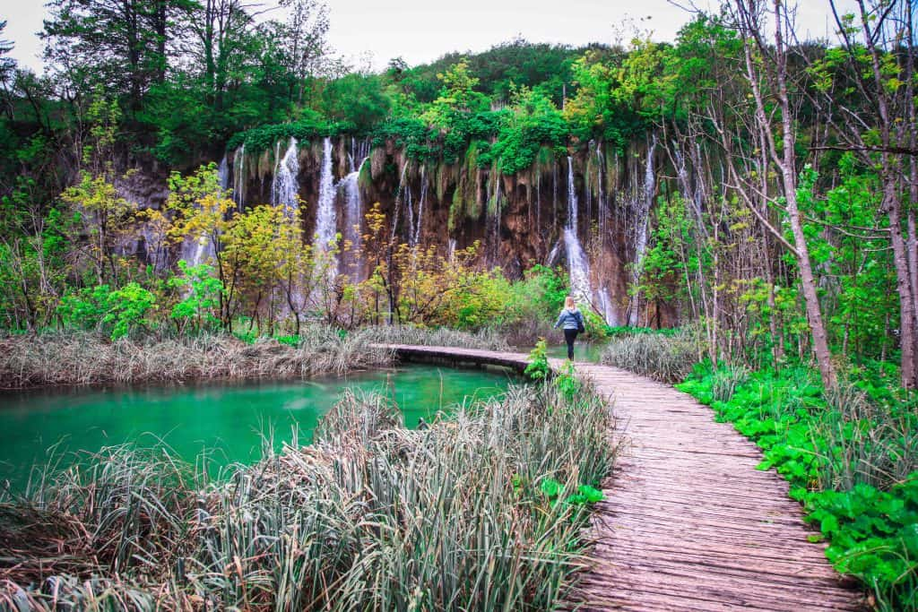 Walking along the path on Plitvice Lakes