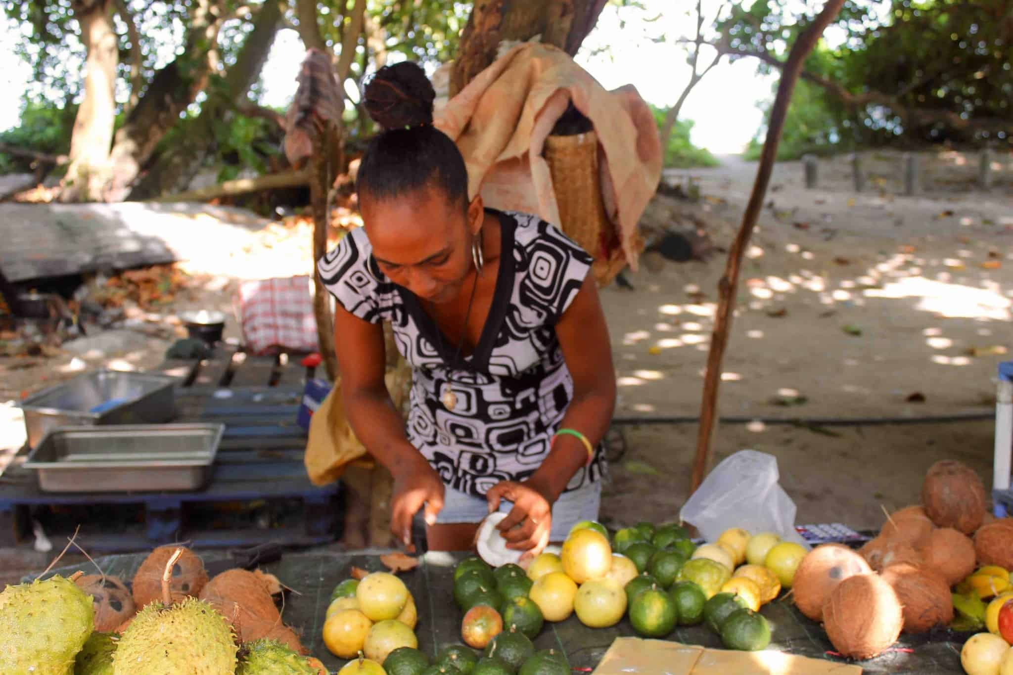 Woman in The Seychelles cutting coconut