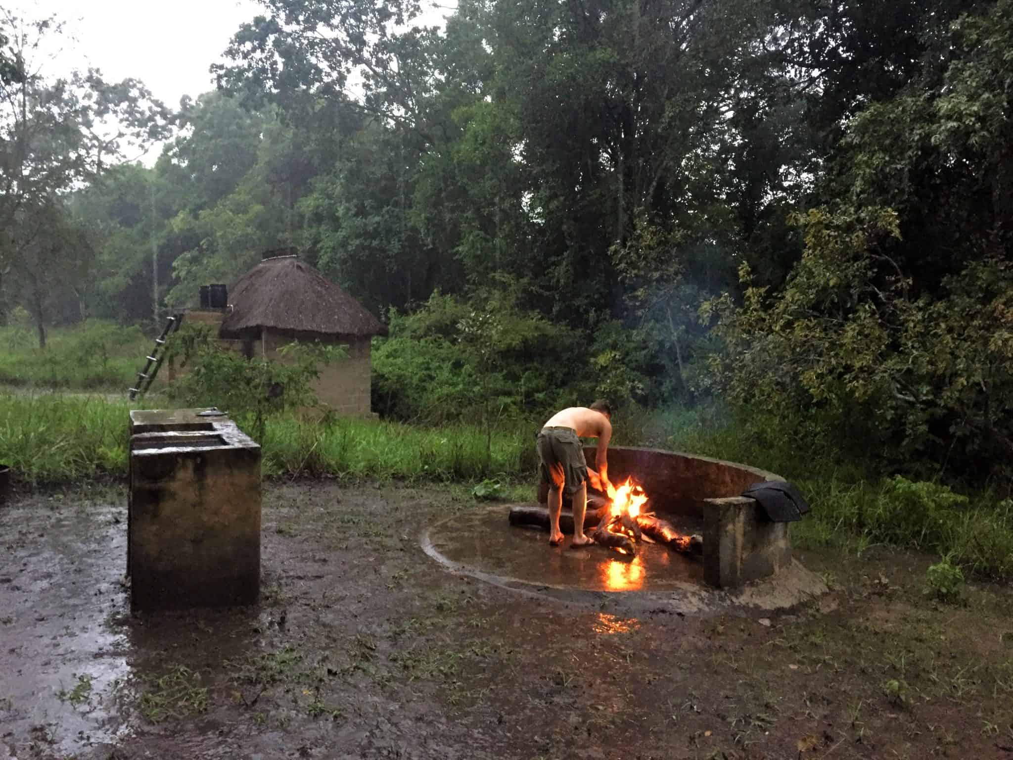 Stoking the fire in the rainy season of Zambia in Kasanga National Park