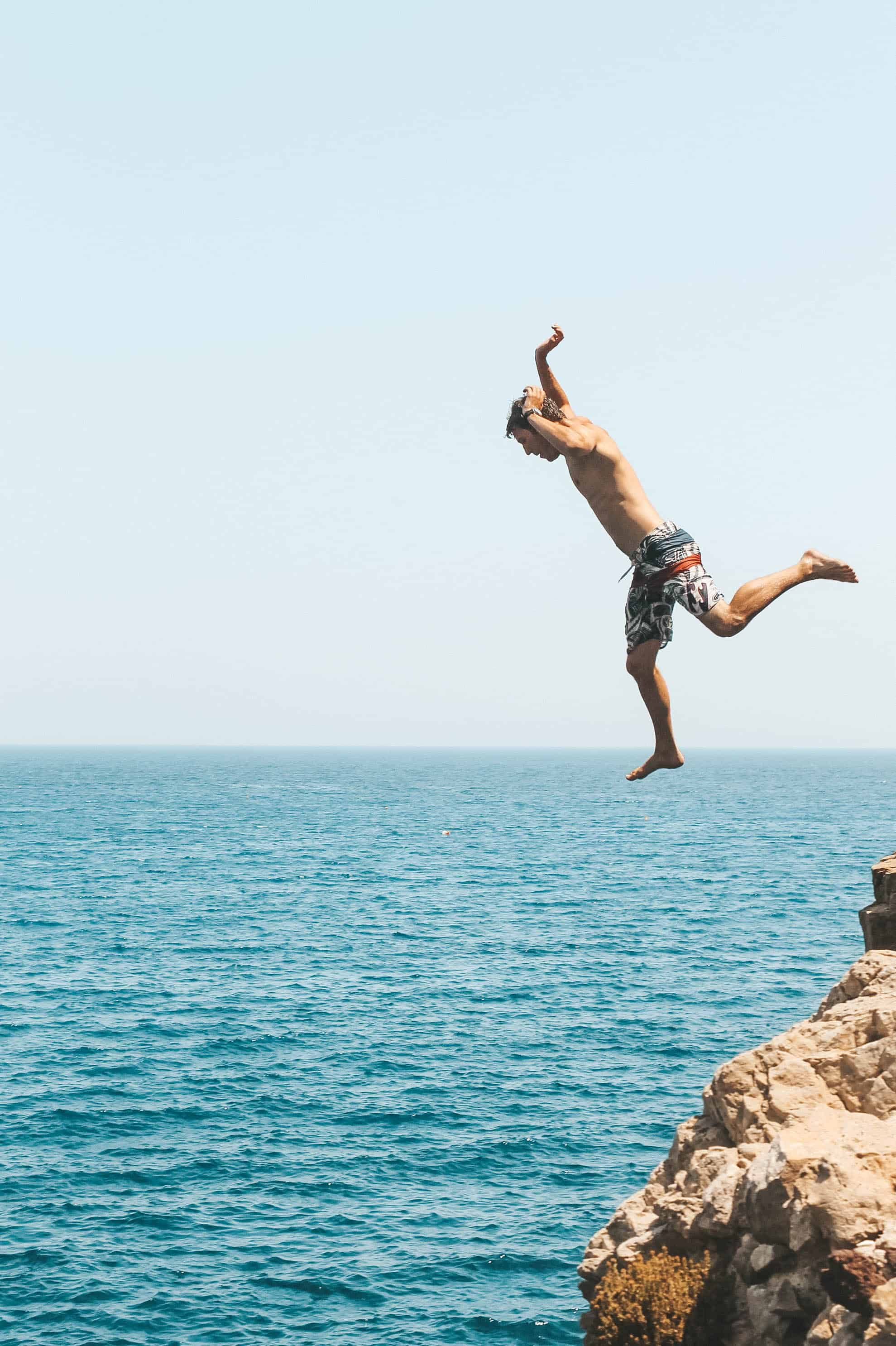 Cliff jumping in Santorini