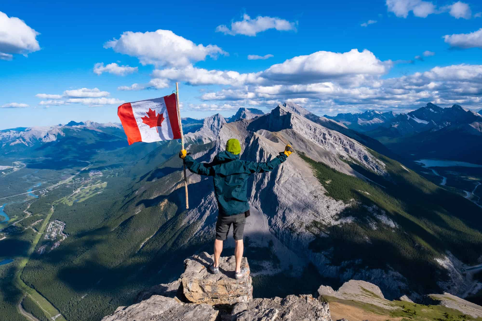 Standing on East End of Rundle With Canadian Flag