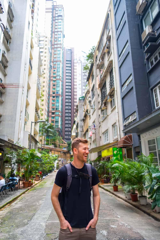 Cameron wearing the Knack Travel Backpack in Hong Kong