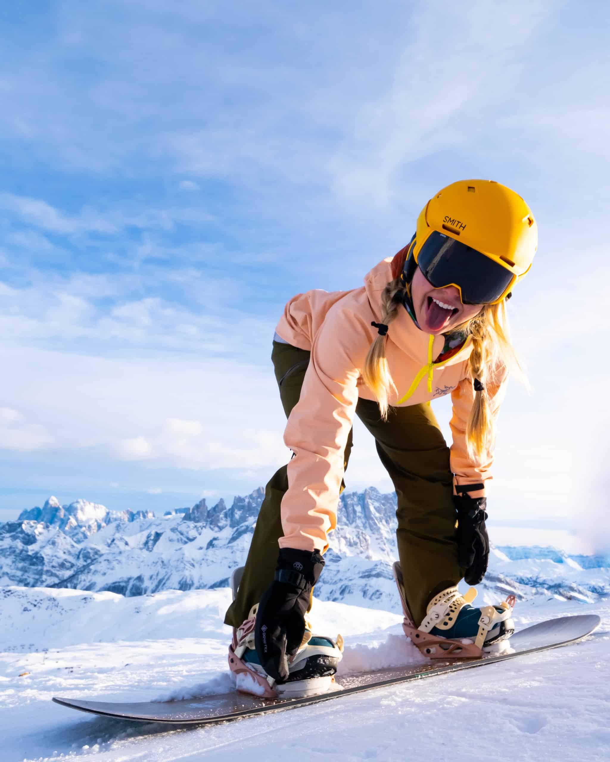 Nathasha at Ski Dolomiti wearing Arc'teryx Ski Outfit Smith 4d Goggles Smith Vantage Helmet and a Jones Flagship with Burton Lexa bindings