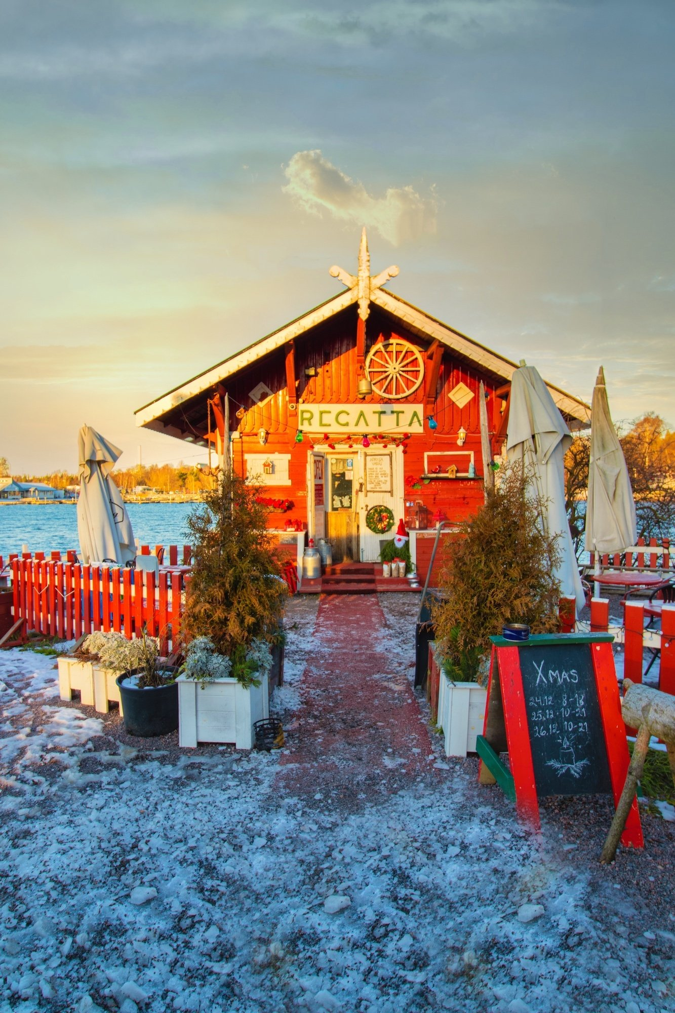 Cafe Regatta in Helsinki is a cozy red cabin right on the water and a great reason to visit Helsinki