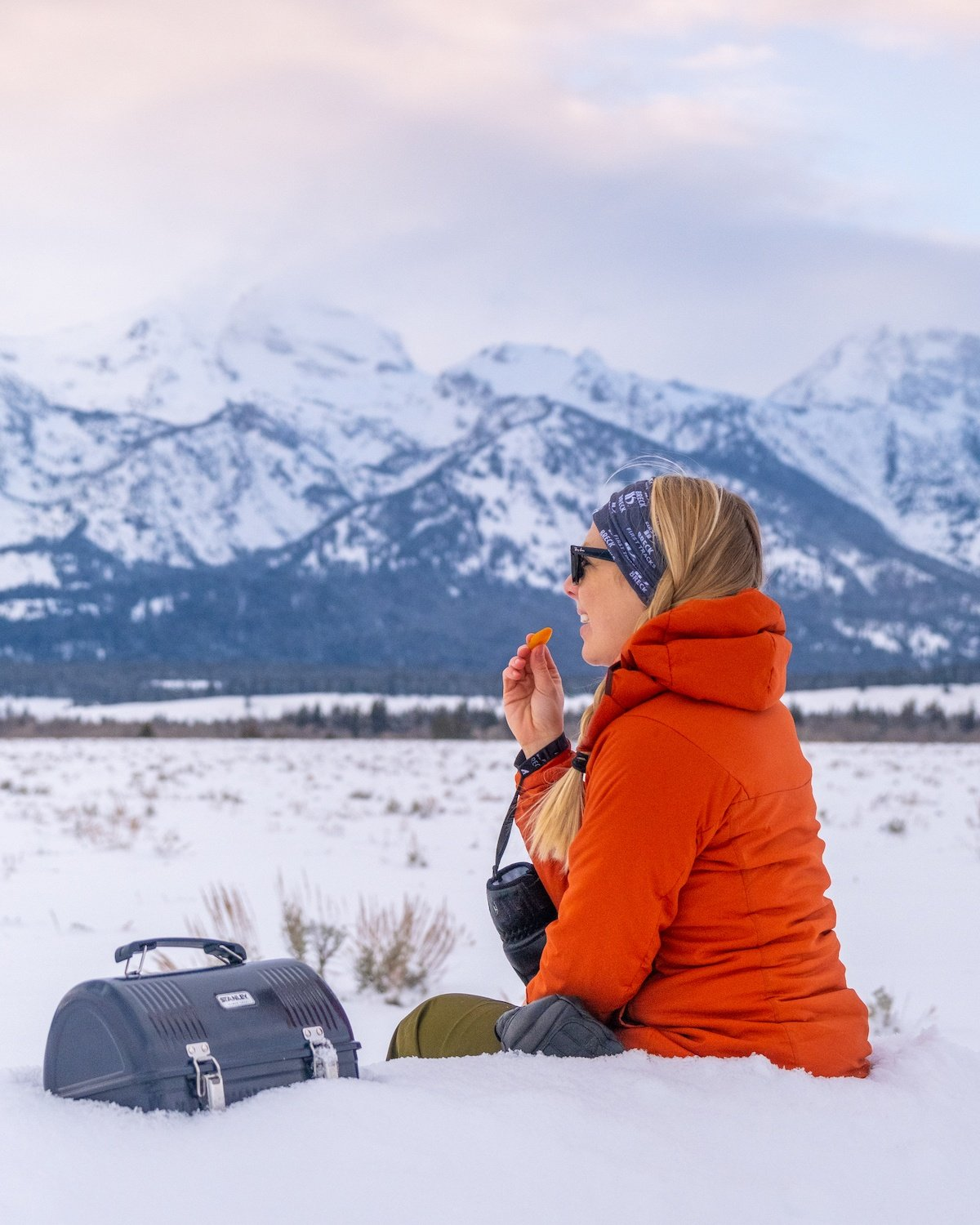 Natasha in Jackson Hole With Stanley Lunch Box and Wearing Arc'teryx Atom LT Hoody