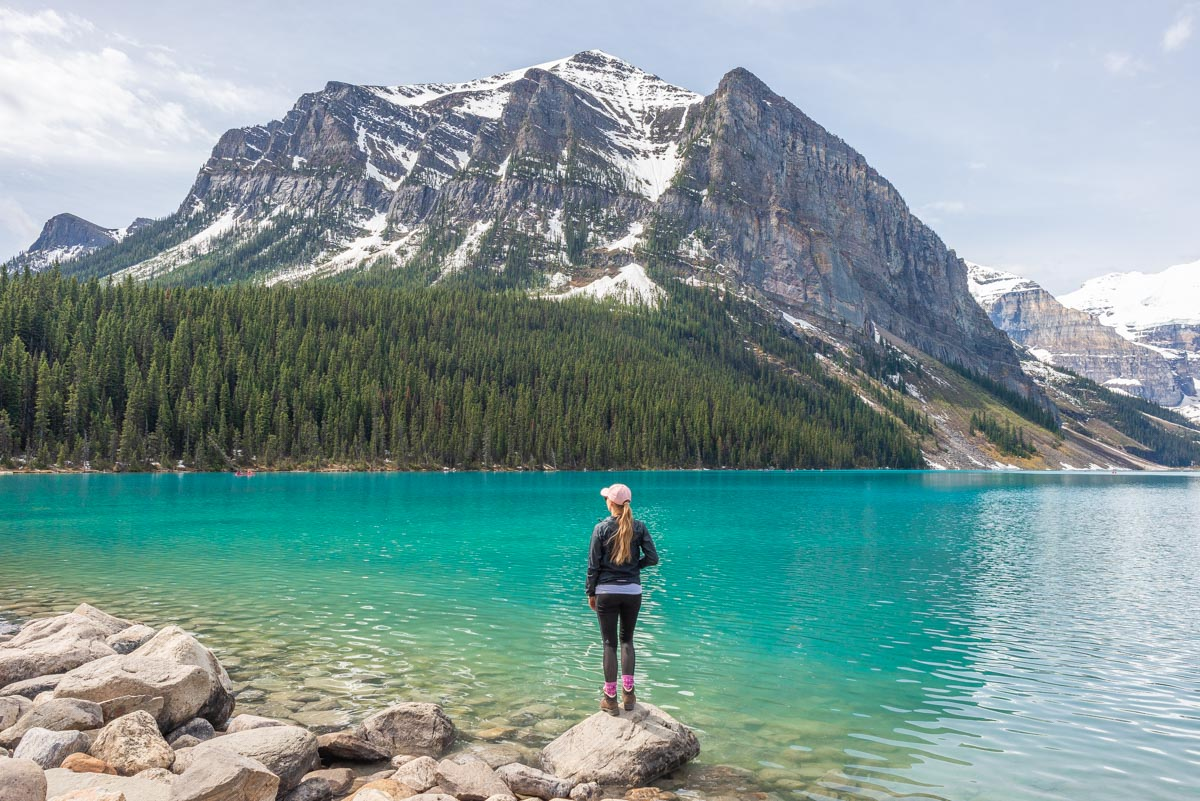 standing at the edge of Lake Louise