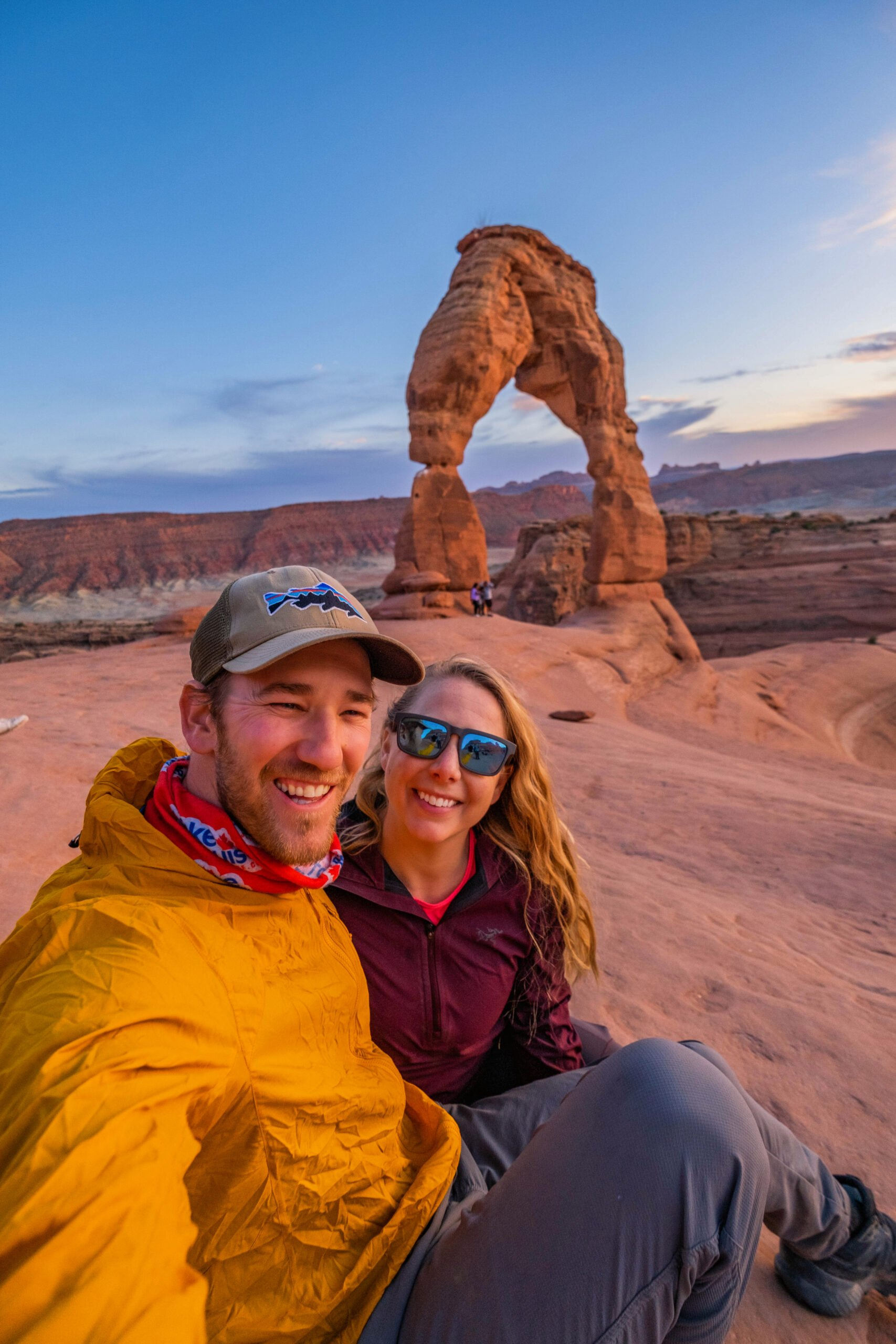 Cameron And Natasha after a hike to the Delicate Arch in Utah