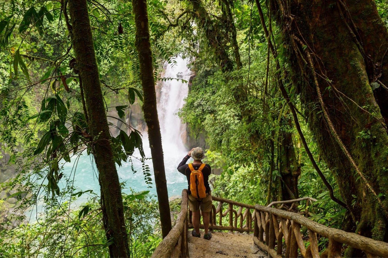 Hiker taking a photo of Rio Celeste in Costa Rica