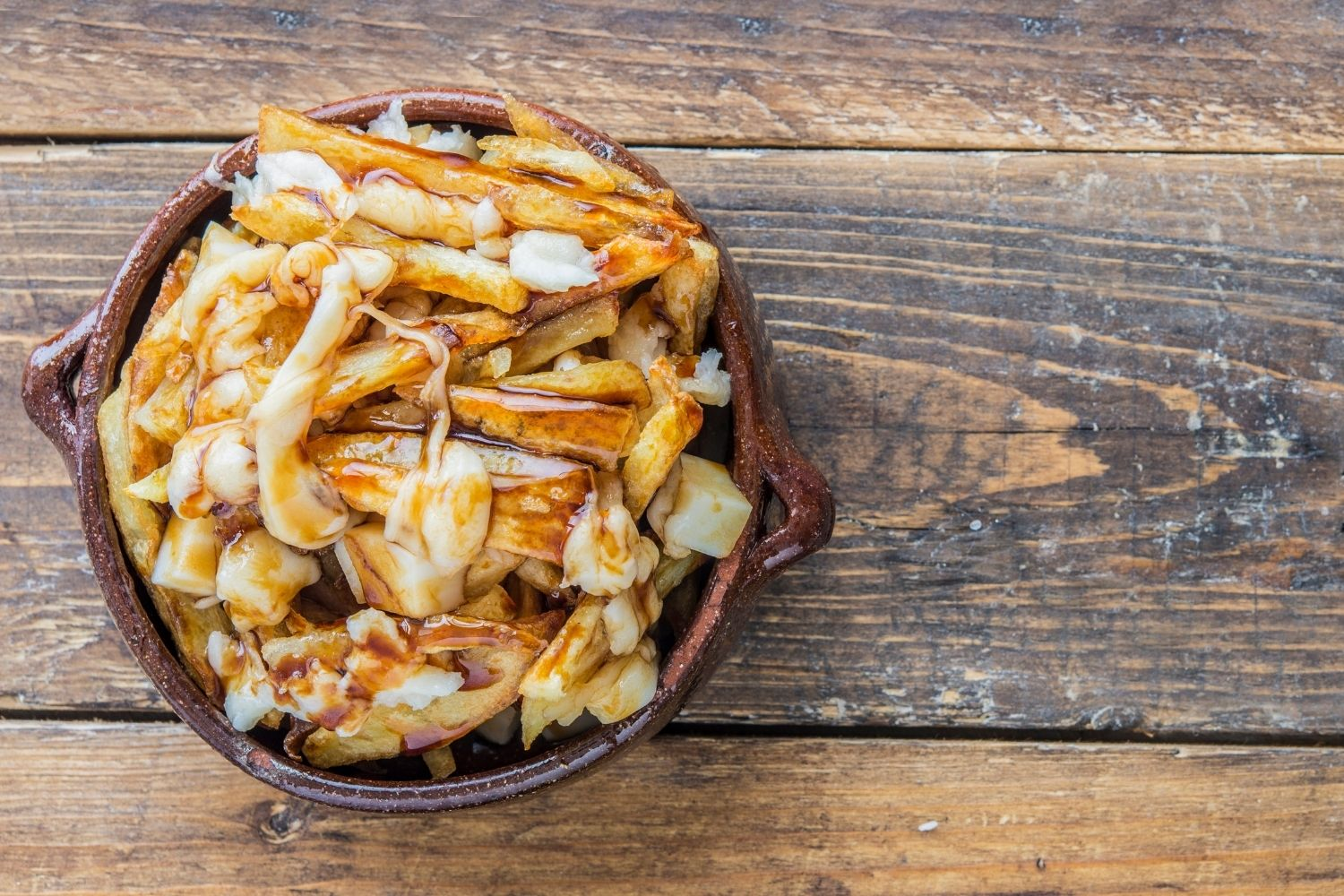 Poutine on wood table
